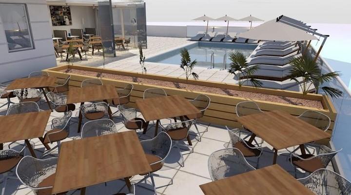 Zwembad en terras bij Hotel Vila Trpe