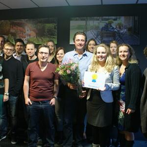 Team van Belvilla op de foto met Award